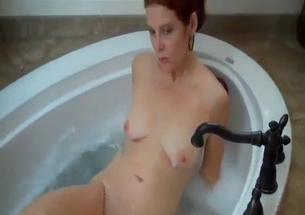 Redhead mommy jerks my loaded cock in bathroom