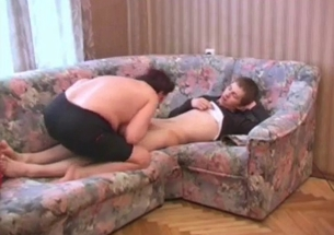 Fat mom with big boobs blows her son on the sofa